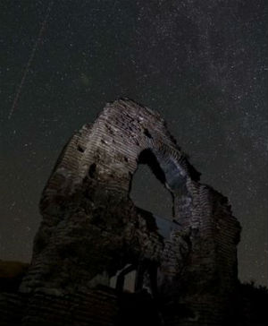 Long exposure image in Bulgarian sky over the remains of Elenska basilica (Nikolay Doychinov/AFP/Getty Images).