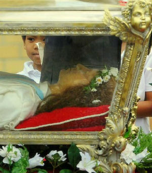St. Maria Goretti's remains are encased inside a glass-sided casket. Inside the casket is a wax statue, which contains her skeletal remains. None of the sacred remains are visible. Nevertheless, the skeleton is complete, with the exception of small fragments that were taken to be placed in altars and for use in the Church's ministry (mariagorettichicago.com).