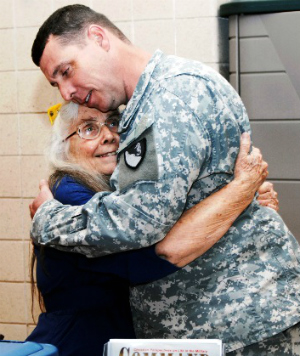 Heart-wrenching story of cancer-stricken 'Hug Lady' receiving amazing gift from thousands of grateful servicemen