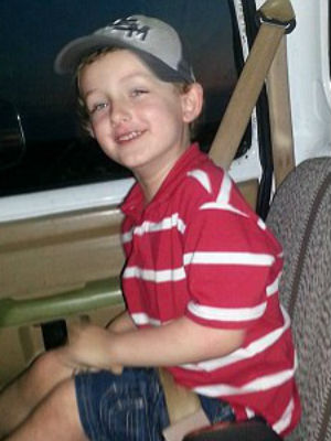 Two policemen shoot and kill Autistic boy strapped in carseat