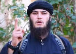 Image of Using his index finger to point to the sky, referring to Allah, the man says,
