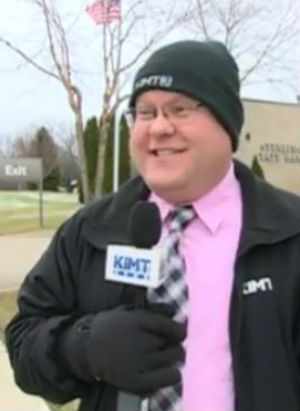 News reporter stops mid-broadcast to call 911 on bank robber suspect (YouTube).