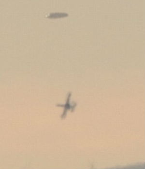 AMAZING 'X-FILE' PHOTOS: Saucer-shaped UFO chased by military aircraft in Bulgaria