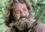 Image of The brawny actor with long hair and flowing beard played Grizzly Adams, a man wrongly accused of murder who takes to the wilderness.