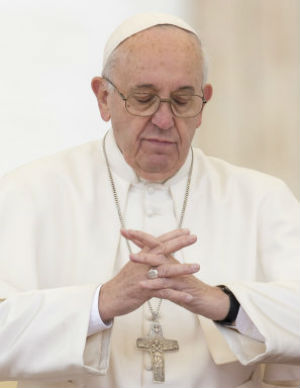 Pope Francis prays for peace in the New Year (AP).