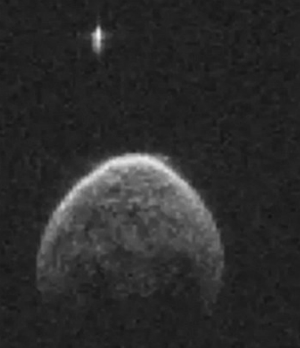 Experts locate UFO in mysterious NASA photos.