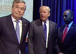 Image of When candidates Marco Rubio and Jeb Bush's names were announced, the two men were still blocking their way. Sneaking past, Jeb grinned and bumped Donald Trump. Photo courtesy of ABC News.