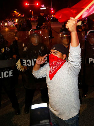 'He deserves what he gets:' Latino youths violently protest Donald Trump in Orange County
