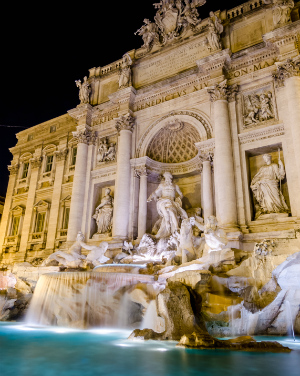 Why is the Trevi Fountain being dyed blood red?