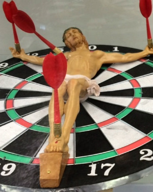 Sickening portrayal of Jesus pinned to a dartboard presented as art in university library