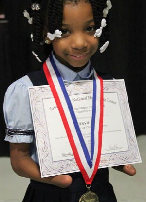 First-grader boasts National handwriting award despite having NO HANDS