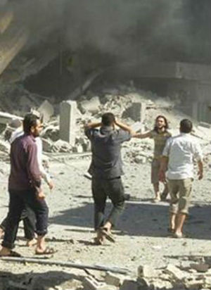 28 killed in refugee camp targeted by Assad's missiles