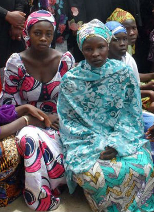 Boko Haram is worse than most understand as Chibok girls take the stage (AFP).