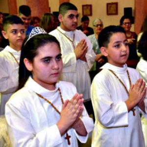 Iraqi refugee children make First Communion