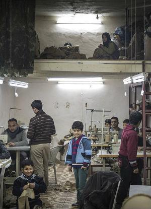 Turkish children forced to work 12 hour days to make terrorist combat gear