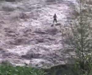 WATCH what happens to this hapless fisherman as the water around him rises...