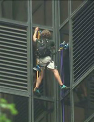 Man attempts to scale Trump Tower with suction cups