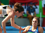 Image of Abbey D'Agostino stopped to help a competitor in the middle of an Olympic race.