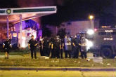 Image of Milwaukee police hold a standoff with protesters following a fatal  police shooting.