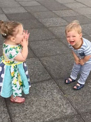 Adorable squeals of joy - Toddlers caught on tape offering kisses between fits of laughter