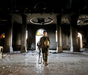 FINALLY FREE FROM ISIS: Christians celebrate first Mass in two years within church's charred remains