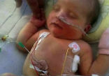 Image of Little Frankie received a miracle (Alex Cousins/SWNS).