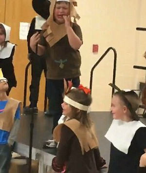 Thanksgiving play ends in tears when heartless teacher yanks microphone from autistic boy before he can deliver his only line