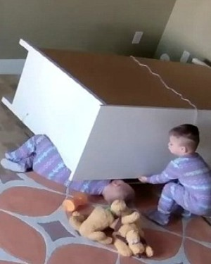 Miraculous moment Jesus helps baby boy rescue twin brother from beneath fallen furniture