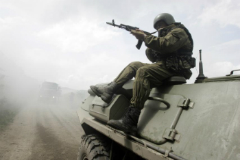 A Russian soldier rides on an armored vehicle in this file image.