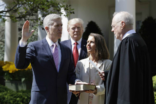 Neil Gorsuch is sworn in at the White House rose garden.