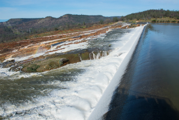 Water breaches the spillway at Oroville Dam on Feb. 12.
