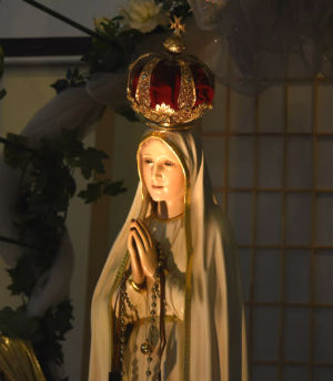 On May 13, 1917, Mary appeared to three shepherd children bringing requests for the recitation of the rosary, for sacrifices on behalf of sinners, and a three-part secret regarding the fate of the world.