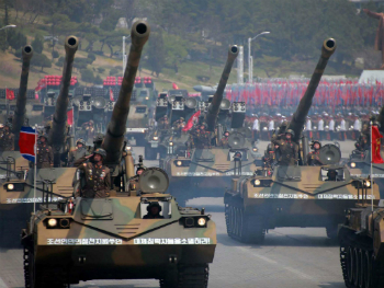 North Korean artillery on parade. It isn't their nukes we should be worried about, but rather their divisive diplomatic policy, designed to frighten the United States and South Korea apart. Once separated, the South becomes vulnerable, and the North strikes.