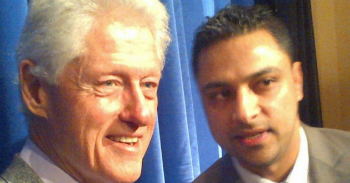 Awan with Bill Clinton. Awan is accused of breaking a number of crimes including transferring sensitive data offsite and fraud.