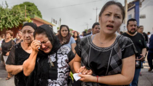 Women mourn as workers search for survivors of the 8.1 quake that struck Mexico in early September.