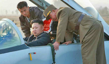 Kim Jong Un sits in the cockpit of a MiG 29 'Fulcrum' fighter.