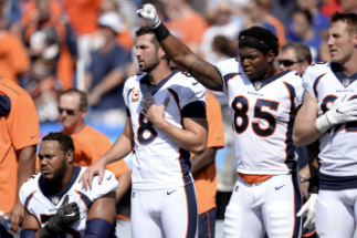 Some players saluted, others protested during the playing of the national anthem at Sunday's football games.
