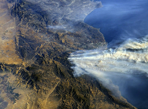 A photo from the International Space Station shows smoke from the fires blowing out to sea.
