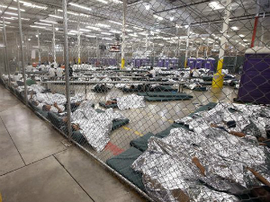 Children are being held in detention centers like this former converted Wal Mart. Children are held while their parents are prosecuted under Jeff Sessions Zero Tolerance policy.