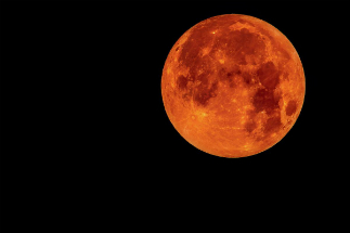 During a lunar eclipse, the moon can turn orange to blood red or black.