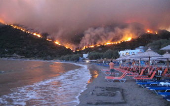 A man takes refuge on a beach in Greece as fires ravage the country.