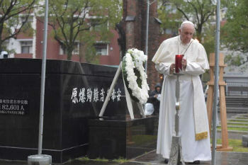 Pope Francis prays at the Nagasaki ground zero site on Nov 24 2019