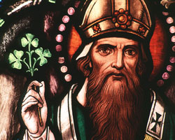 ST. PATRICK � St. Patrick, bishop and missionary to Ireland, is depicted in this stained-glass window at the Crosier Community in Anoka, Minn. Legend says that he used the shamrock to describe the Trinity to those he sought to convert. His feast day is March 17. (CNS photo/Crosiers Photography)