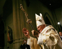 Joined by the Archbishop of New York, Edward Cardinal Egan, (red hat, standing), Pope Benedict XVI prays at the altar dedicated to Saint Louis IX behind the main altar, before the Blessed Sacrament at Saint Patrick's Cathedral in New York April 19, 2008.