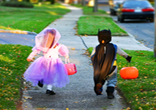 Image of Happy trick or treaters on Halloween.