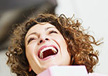 Image of Woman laughing out loud.