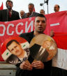Image of Syrians rally in favor of Assad and Putin.