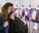 Image of A woman covers her mouth as she views shocking images smuggled out of Syria on display at the UN headquarters in New York (Reuters).