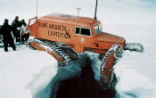 Image of A Snow Cat vehicle, used in an expedition to Antarctica in 1957-58. Scientists continue to study the last pristine continent on the planet, to learn what it can teach us about the rest of Earth.