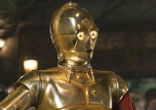 Image of Giddy android C-3PO returns, albeit with a red arm contrasting to his shiny golden suit of armor. The previous arm is revealed to have been lost in a previous misadventure.